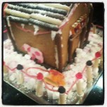 Gingerbread house with pet cow and sled